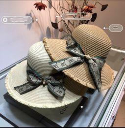 Grandi cappelli eleganti online-La grande protezione solare della spiaggia del cappello signora della grata deve essere grande cappello del cappello di paglia del cappello di paglia di modo di gronde e affascinanti di modo