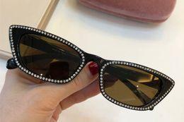 10US Новые горячие продажи бренда очки безрамные очаровательные очки кошачий глаз для женщин тенденция авангардный стиль uv400 линзы очки высокого качества cheap hot style trends от Поставщики горячие тенденции стиля