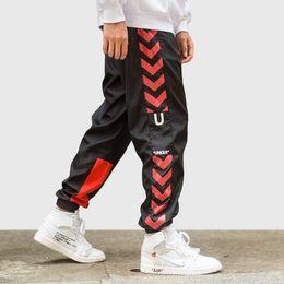 pantalones de harem negro Rebajas Pantalón Joggers de hombre Hip Hop Flecha  lateral Imprimir Sudor Retro 714c174019f