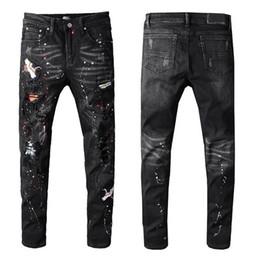 Tendência de moda bordados on-line-Amiri Jeans Mens Rock Revival Buraco Denim Trousers Bordados pintados calças retas calças Fashion Trend motocicleta Casual calças Hip hop selvagem