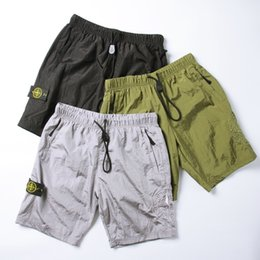 Pantalon spandex en Ligne-pantalon de sport en nylon à séchage rapide respirant doublure en maille boussole pantalon de plage brodé