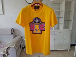 Camiseta amarilla barata online-2019 Balmain Camisetas Playa Recta Moda Rosa Amarillo encantador Hombres Mujeres Camisetas Algodón Playa Viento Ropa barata