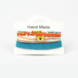 l'occhio di fascino fortunato Sconti Nuovi braccialetti fatti a mano del fiore della Boemia mette le donne 2019 Nuovi braccialetti della corda Retro accessori dei gioielli Braccialetto fortunato di Hamsa dell'occhio diabolico