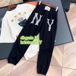 Moda unisex rhinestone pantalón con letra impresa Pantalones de jogging relajados pantalones en forma de cintura elástica con cordón deportivo desde fabricantes