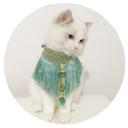 bolas de kong Desconto Kong Quelan Franjas Bola De Pêlo Egípcio Vento Vermelho Pet Cat Collar Filhote De Cachorro Roupas Vestido Y19061901