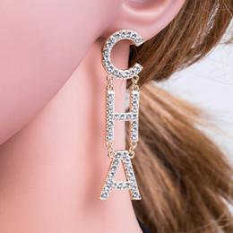 2019 Nuevos Pendientes de Diseñador Joyas de Diseñador Joyería de Lujo Diseñador Pendientes Pendientes de diamantes Aleación Rhinestone Señoras desde fabricantes