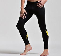 2019 uomini di calzoni gialli I pantaloni da corsa termici sexy lunghi di yoga di allungamento delle calzamaglia legging lunghi sexy degli uomini regolano il nero blu rosso rosso Trasporto libero uomini di calzoni gialli economici