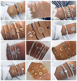 le ragazze di amore del silicone Sconti 19 stili punk mappa tartaruga cuore lettera amore perline di cristallo catena multistrato pendente braccialetto d'oro set di fascino ragazza gioielli regalo HZSSL1