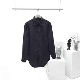 2019 blusa de botão branco Nova malha de bolso com botão de mangas compridas profissional punhos pontas das mulheres para baixo frete grátis tecido blusa branca desconto blusa de botão branco