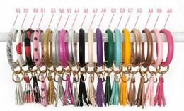 Boho Chic Armbänder PU-Leder-O-Ring-Schlüsselanhänger Bunte Kundenspezifischer Kreis Quaste Armband Armband Schlüsselanhänger Mädchen-Schlüsselring-T287 von Fabrikanten