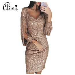 ea5431d44f Plus Size Sexy Sequin Tassels Dress Women Sexy Bodycon Hollow Out Long  Sleeve V-neck Midi Party Club Dress Vestidos de Festa