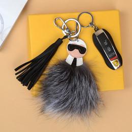badge della squadra di calcio Sconti 2018 lusso logo Fluffy Karl Genuine pelliccia di procione Pompon Bag mostro Bugs fascino anello chiave di Keychain della peluche in pelle nappa PomponFendi