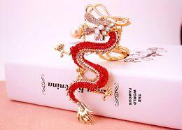 2019 dragón del metal chino Estilo chino zodiaco creativo artesanía dragón con cadena de diamantes llavero de los hombres llavero colgante de metal rebajas dragón del metal chino