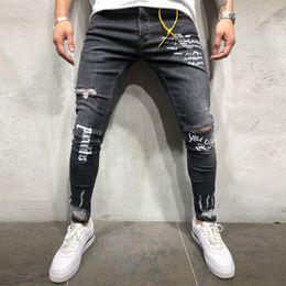 рваные джинсы корейские мужчины Скидка Fashion Denim Men Korean Style Hip Hop Black Letter Print Jeans Masculino Elastic Pencil Trousers Ripped Jeans For Men Pants 20