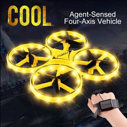 Quadcopter remoto online-Mini Quadcopter inducción Drone inteligente reloj remoto Gesto de detección de aeronaves OVNI Juguetes somatosensoriales noctilucentes Interacción Uav