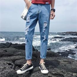 2019 рваные джинсы корейские мужчины Wholesale 2019 Spring autumn boys teenagers Male Korean feet men's trousers jeans ripped hole loose handsome cow pencil pants дешево рваные джинсы корейские мужчины