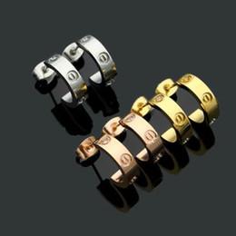 il gancio all'ingrosso dei monili di s Sconti Prezzo di fabbrica famoso designer all'ingrosso vite in acciaio di titanio con orecchini trapano semi-circolare di apertura con orecchini trapano per le donne regalo