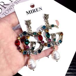 Senhora de jade on-line-2019 hot metal earrings designer de moda para criar brincos de cristal elegante senhoras brincos de marca frete grátis 0730