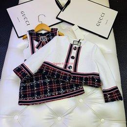Argentina Vestido de chaleco para niña otoño e invierno moda niños ropa de diseñador chaqueta de punto + falda a cuadros 2 piezas forro de tela compuesta conjuntos de algodón Suministro