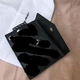 Argentina Paquete de tarjeta de la marca 19ss, apague el bolso a rayas blanco y negro Monedero clip de la carpeta del bolso carpeta de la moda hip hop casual Suministro