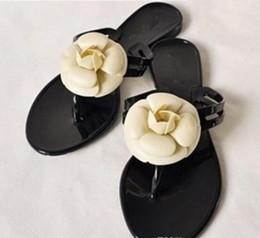 Designer femmes pantoufles fleurs chaussures sandales plates de plage New Retros femmes chaussures en cuir de haute qualité causant de bain Flip Flops ? partir de fabricateur