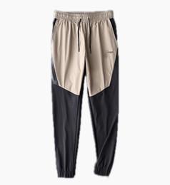 Vêtements amples pour hommes en Ligne-Designer Couple Vêtements Casual Hommes Pantalons 2019 Hommes Marque Pantalon Plus La Taille Nouvelle Arrivée En Vrac Hommes Luxe Vente Chaude Pantalon Taille Élastique