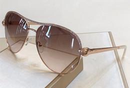 cabeza de serpiente de metal Rebajas 1011 nuevas mujeres de lujo de diseño cabeza de serpiente gafas de sol de estilo barroco gafas de diamante de metal de calidad superior UV400 gafas de protección con caja