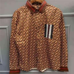 2019 padrões da camisa da luva dos homens longos Mens Designer Camisas Casuais Mangas Compridas Listrado Bolso Camisas Da Marca de Moda Cáqui Padrão Imprimir Camisola Fino para Mens Roupas de Luxo