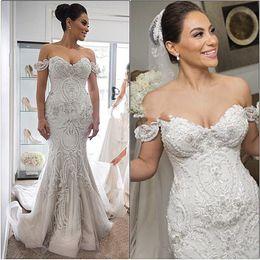2020 Steven Khalil erstaunliche Details Strand Mermaid Brautkleider Dubai Arabisch Off-Schulter-Schatz-Backless billig Brautkleid Plus Size von Fabrikanten