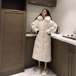 Schwarze gesteppte pelzjacke online-Cazadora mujer Gepolsterte warme Daunenjacken Damen Winter Plus Size Lange gesteppte schwarze Kapuze Pelzmantel Jacke 2018 Parkas für Frauen