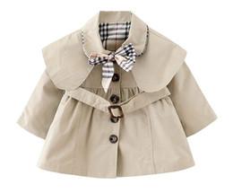 Nueva Baby Girls Trench capa delgada con pajarita y cinturón Otoño primavera Moda Chaqueta a prueba de viento niñas con capucha capa capa desde fabricantes