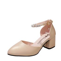 Robe coréenne de chaussure de dames en Ligne-Robe printemps et l'été version coréenne de l'arc noir creux pointé talons hauts bouche peu profonde chaussures sexy mode dames sauvages