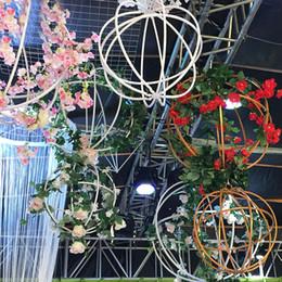 accessoires de fleurs suspendus Promotion En fer forgé rond pli Ball suspendus boule de fer télescopique pour la décoration de mariage accessoires de fond Party Stage Flower Decor boule suspendue