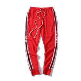 Pantalones de cordón para hombre online-2019 Nuevos Pantalones de Hombre Pantalones de chándal de diseñador Pantalones de chándal de marca de moda Ropa de chándal de raya lateral Pantalones de los hombres Marca Pantalones deportivos de chándal