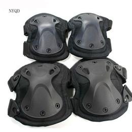 4pcs / set !!! Ginocchio protettore moto Migliore qualità! gomito del ginocchio Tactical paintball protezioni protezioni gomiti NERO da pattini di paintball fornitori