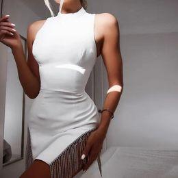 Canada Summer Party sans manches Sexy Pure Color White Spliced Bright collier de forage à franges robe fille femmes portent une jupe cheap pure white skirts Offre