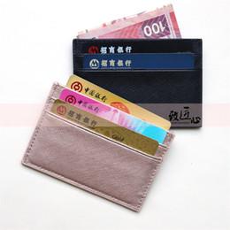 DOKDO Calidad superior Dama estilo diseñador de lujo clásico hombres famosos mujeres Saffiano titular de tarjeta de crédito de cuero genuino mini billetera desde fabricantes