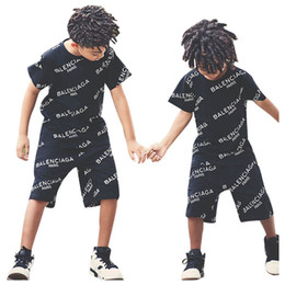 2019 зебры брюки для детей Горячие продажи дети спортивный костюм набор мальчиков костюмы лето письмо с коротким рукавом футболка + шорты 2 шт. / компл. повседневная мальчики одежда устанавливает мальчики одежда A9068