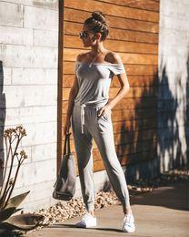 peplum jumpsuit shorts Rabatt 2019 Off Shoulder Frauen Sexy Overalls Strampler Unifarbene Anzüge Freizeitkleidung mit grauer Farbe Schulter abfallend 8341 S-XL