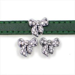 encanto de la pulsera del arco del rhinestone Rebajas El mejor diseño Crystal Bowknot Slide Charms Color plata Rhinestone Bow nudo Slider para pulsera de 8 mm Pulsera DIY Fabricación de joyas