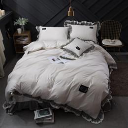 Weiße spitzenbettwäsche-sets online-Luxus Reine Weiße farbe Schwarz Spitze hause baumwolle Bettwäschesatz König Königin Größe Prinzessin koreanische Rüschen Bedskirt bettbezug