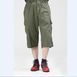 2019 pantalones cortos de hombres gordos Pantalones cortos casuales para hombres de gran tamaño 6XL más tamaño pantalones de algodón gordo suelto gordo de mediana edad pantalones deportivos rebajas pantalones cortos de hombres gordos