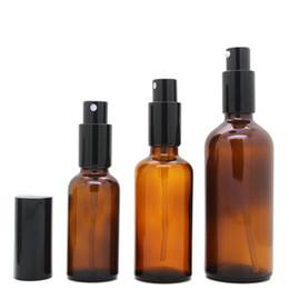 Botella esencial de oro online-30ps 50ml Atomizador Botella 50 ml Vidrio Esencial Aceite Vial rociador Botella de vidrio vacía para Perfume con tapa de oro negro plateado
