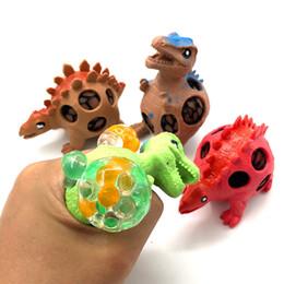 balles spongieuses gros Promotion Nouveauté Drôle Squishy Dinosaure Raisin Ball Animal Modèle Vent Maille Ball Squeeze Décompression Anti Stress Jouet Enfants Cadeau En Gros