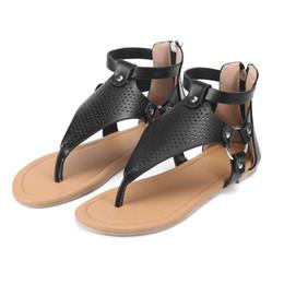 Argentina Nuevo Roman Toe-clip para mujer Sandalias Hollow sandalias de suela plana Cremallera detrás de la cremallera Zapatos de gran tamaño al por mayor Suministro