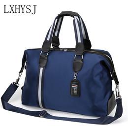 2ef5fcb0fee8 The New Large Capacity Men s Travel Bag Women Waterproof Nylon Travel Bags  Hand Luggage Bag Multifunction Duffle