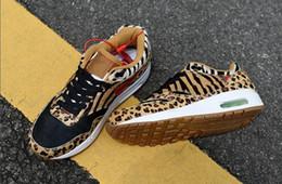 mediados de corte zapatos para correr Rebajas Nueva Llegada 1 87 DLX Airs ATMOS Running Shoes Animal Pack 1s 87s Leopard Gra Men Maxes Mujeres Classic Athletic Zapatos Zapatos tamaño 36-45