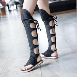 Argentina Las sandalias de verano de las mujeres coreanas botas de corte alto huecas planas con la cara de mezclilla de encaje botas gladiador sandalias Suministro