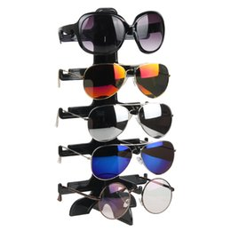 2019 stand 21 5 par de gafas de sol de plástico titular de gafas gafas estante estante de exhibición del organizador Mostrar organizador de la joyería soporte stand 21 baratos