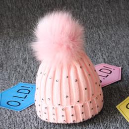 Cappelli di lana per neonati online-Bambino a maglia Diamanti Cappelli Pelliccia Pom Pom Bling Bling Crochet Caps Inverno caldo Neonato Bambini Ragazzi Ragazze Berretto di Lana cap 8 colori C5652